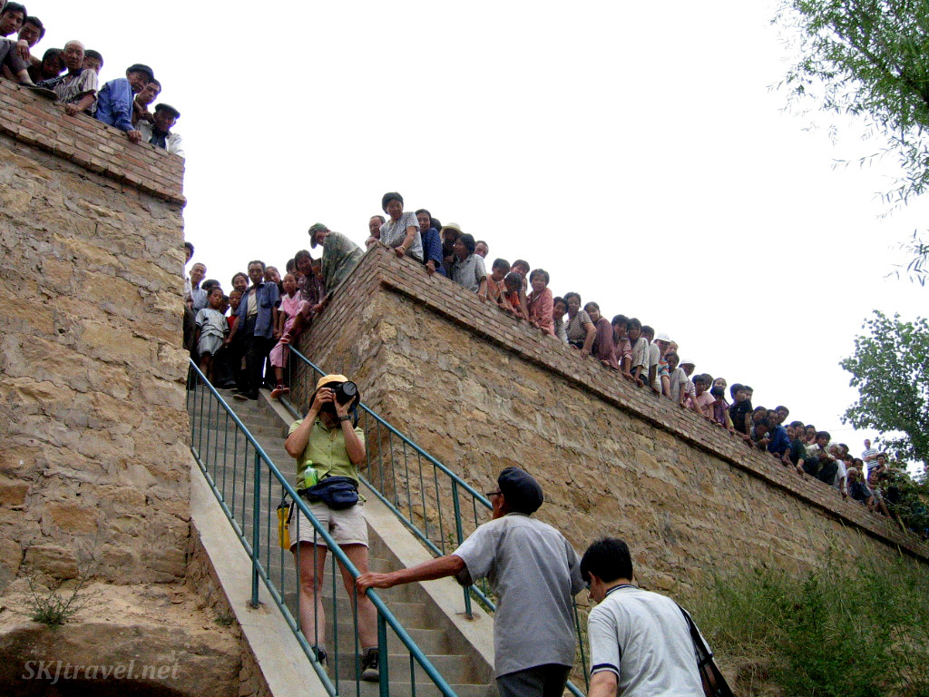 Crowds watching us visit the local temple. Wang Jiabian rain festival. Shaanxi Province, China.