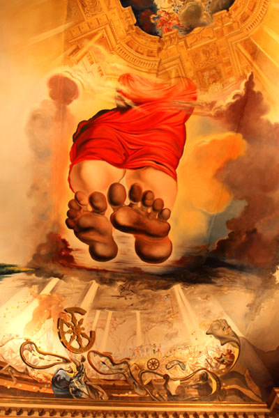 Giant feet of Gala come down from heaven in a Dali painting on a ceiling in Palace of the Wind, Dali Museum, Figueres, Spain.