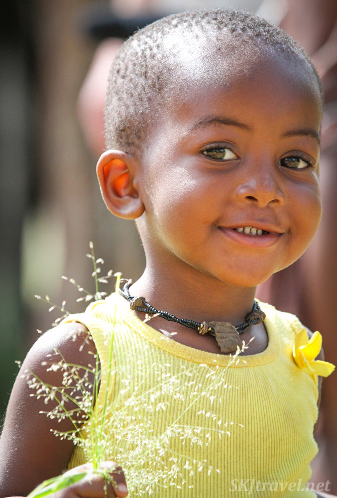 Little Himba girl in yellow. Kunene region of Kaokoland, Namibia.