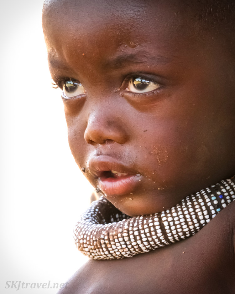 Himba toddler in traditional village, Kunene region of Kaokoland, Namibia.