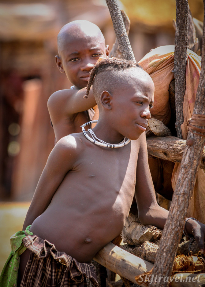 Two Himba boys in their kraal, Kunene region of Kaokoland, Namibia.