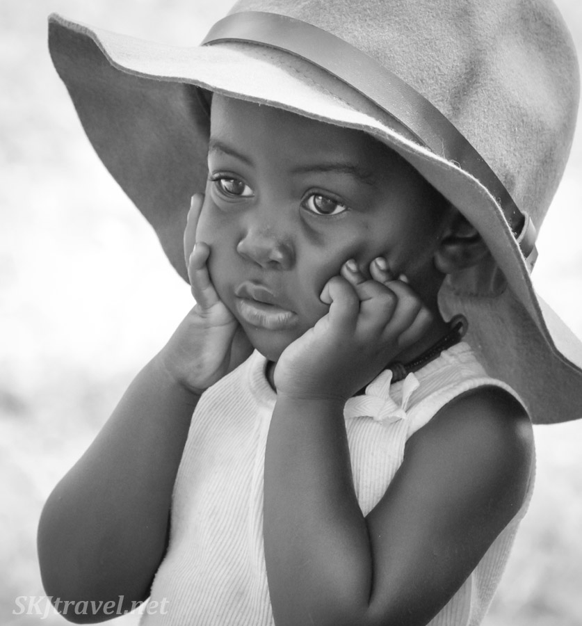 Young Himba girl contemplating something serious. Near Epupa Falls, Namibia.