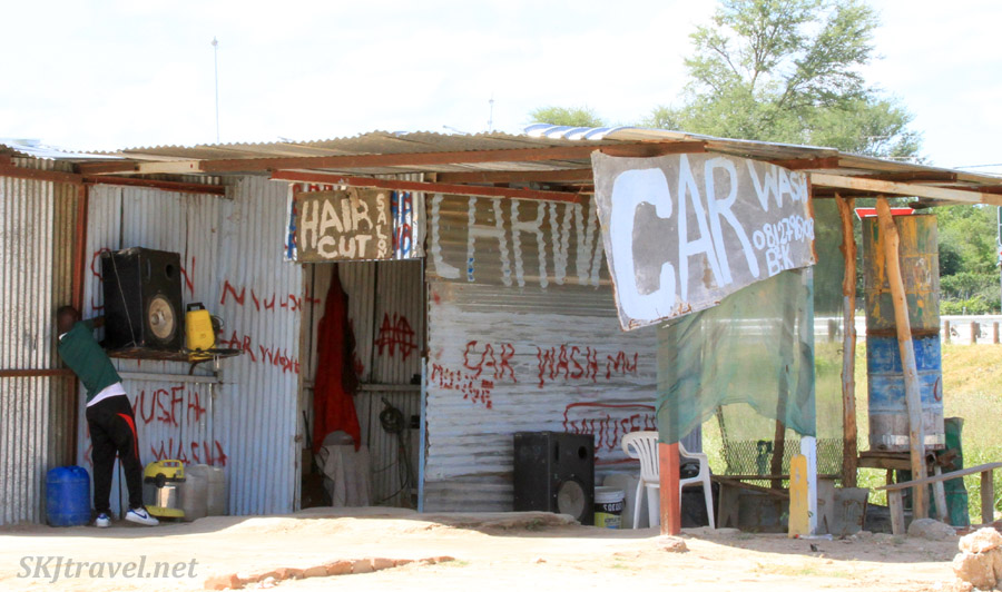 Hair salon and car wash along the roadside, northern Namibia.
