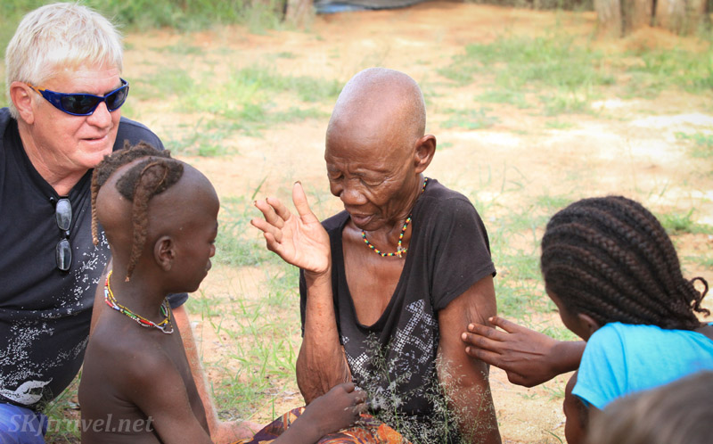 Ndjinaa's caretaker touches her gently on the arm as she speaks to her.