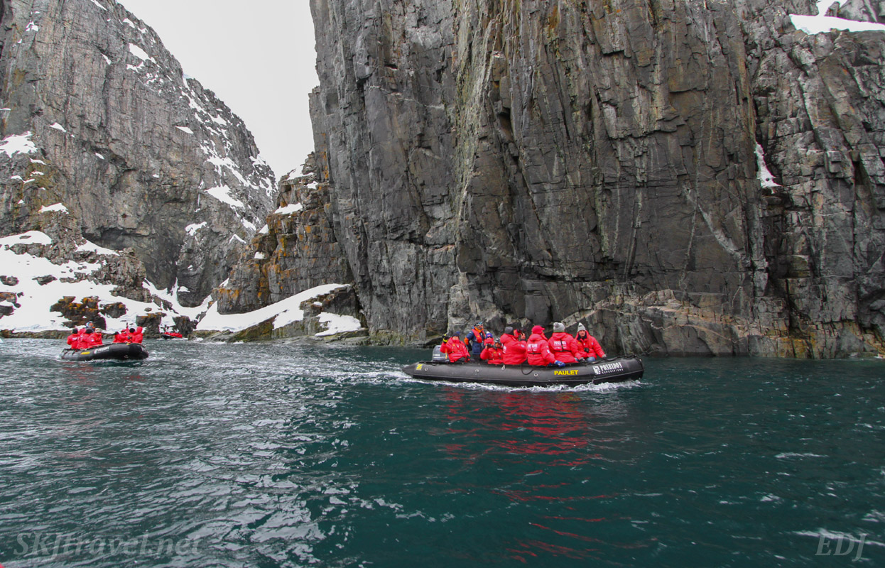 Zodiac cruise at Spert Island, Antarctica, in beautiful green ocean waters.