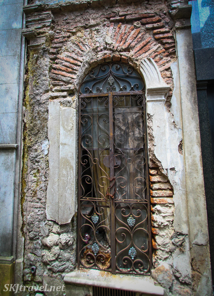 Window to a decaying mausoleum in Recoleta Cemetery, Buenos Aires, Argentina.