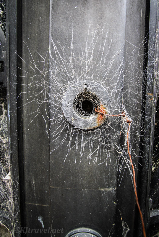 Keyhole enshrouded in cobwebs on the doors to a mausoleum in Recoleta Cemetery, Buenos Aires, Argentina.