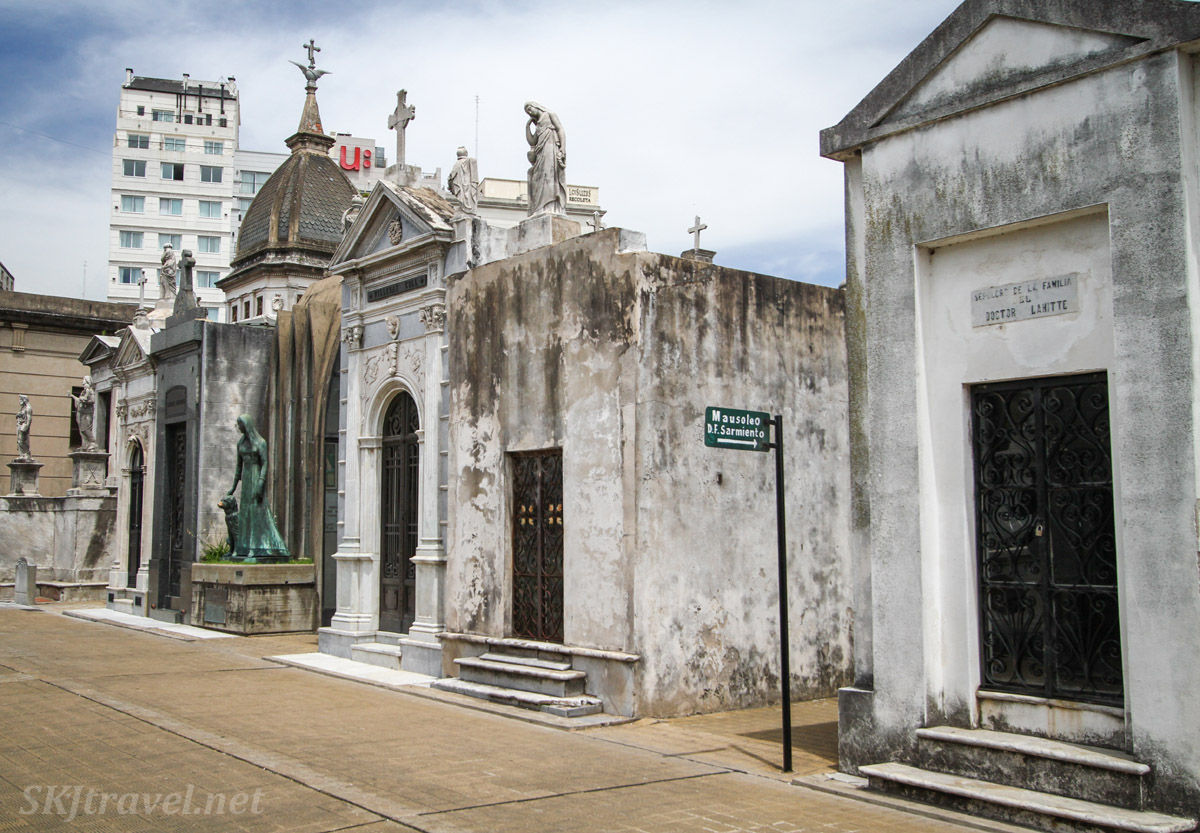 A street in Recoleta Cemetery, Buenos Aires, with sign pointing toward the tomb of Argentina's 7th president, Domingo Sarmiento.