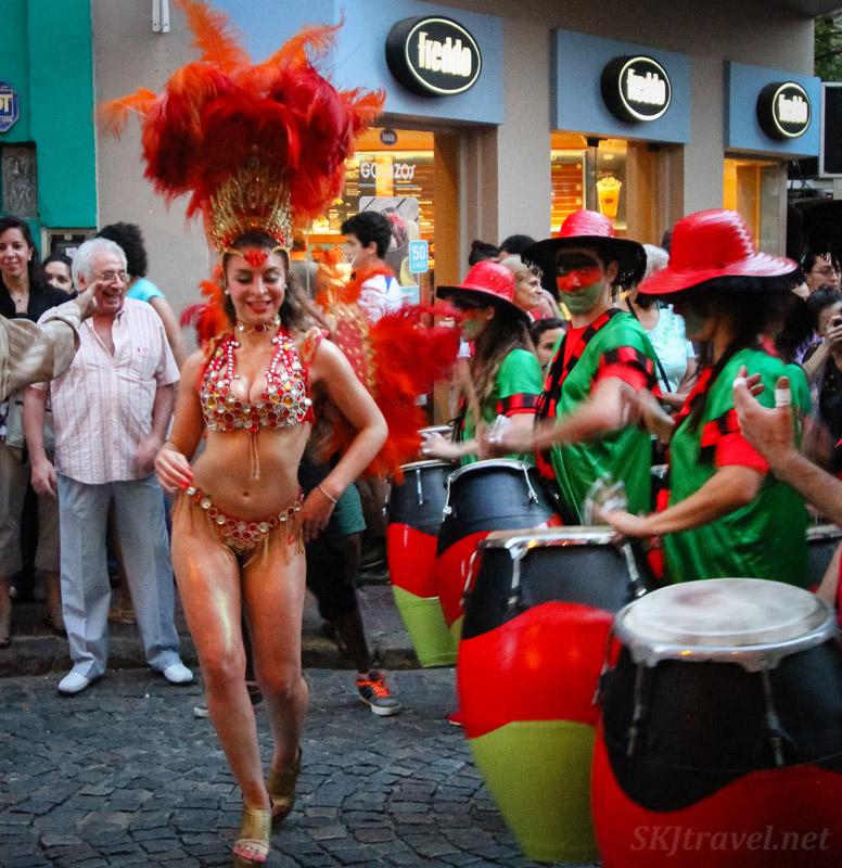 Festive dressed woman Carnaval style leading a comparsa in the San Telmo Candombe parade, Buenos Aires, Argentina.