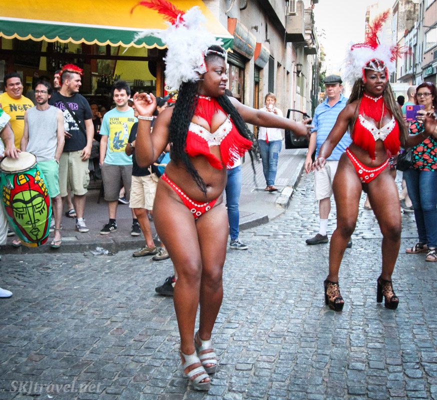 Festive dressed women, Carnaval style, dancing in the San Telmo Candombe parade, Buenos Aires, Argentina.