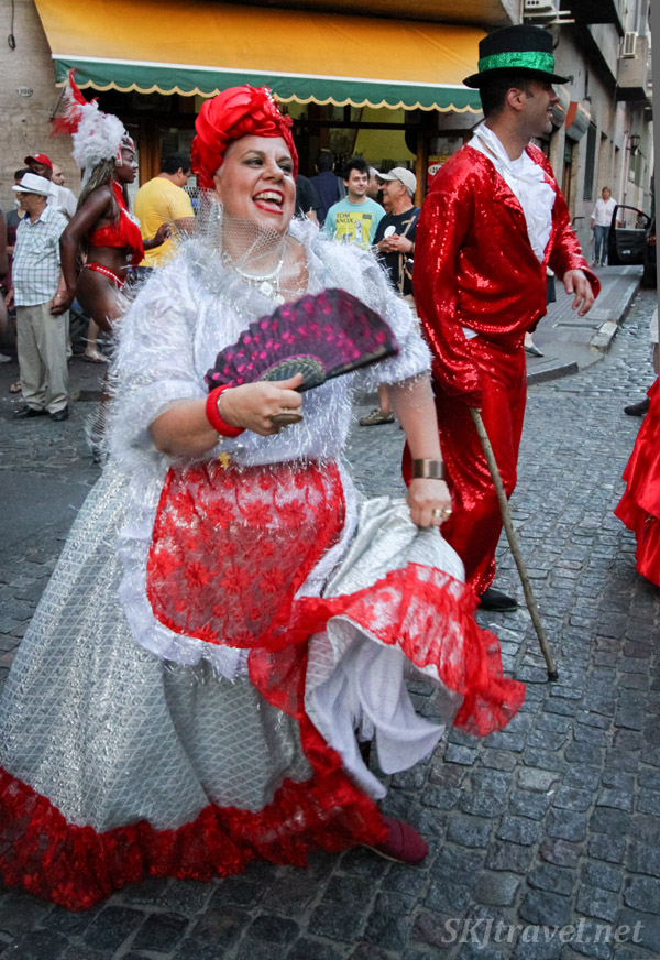 Mama Vieja and Gramillero characters dancing in the San Telmo Candombe parade, Buenos Aires, Argentina.