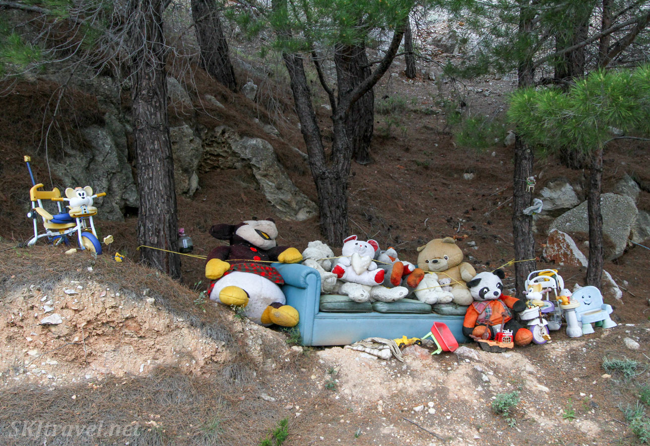 Collection of stuffed animals along the roadside on Chios Island, Greece.