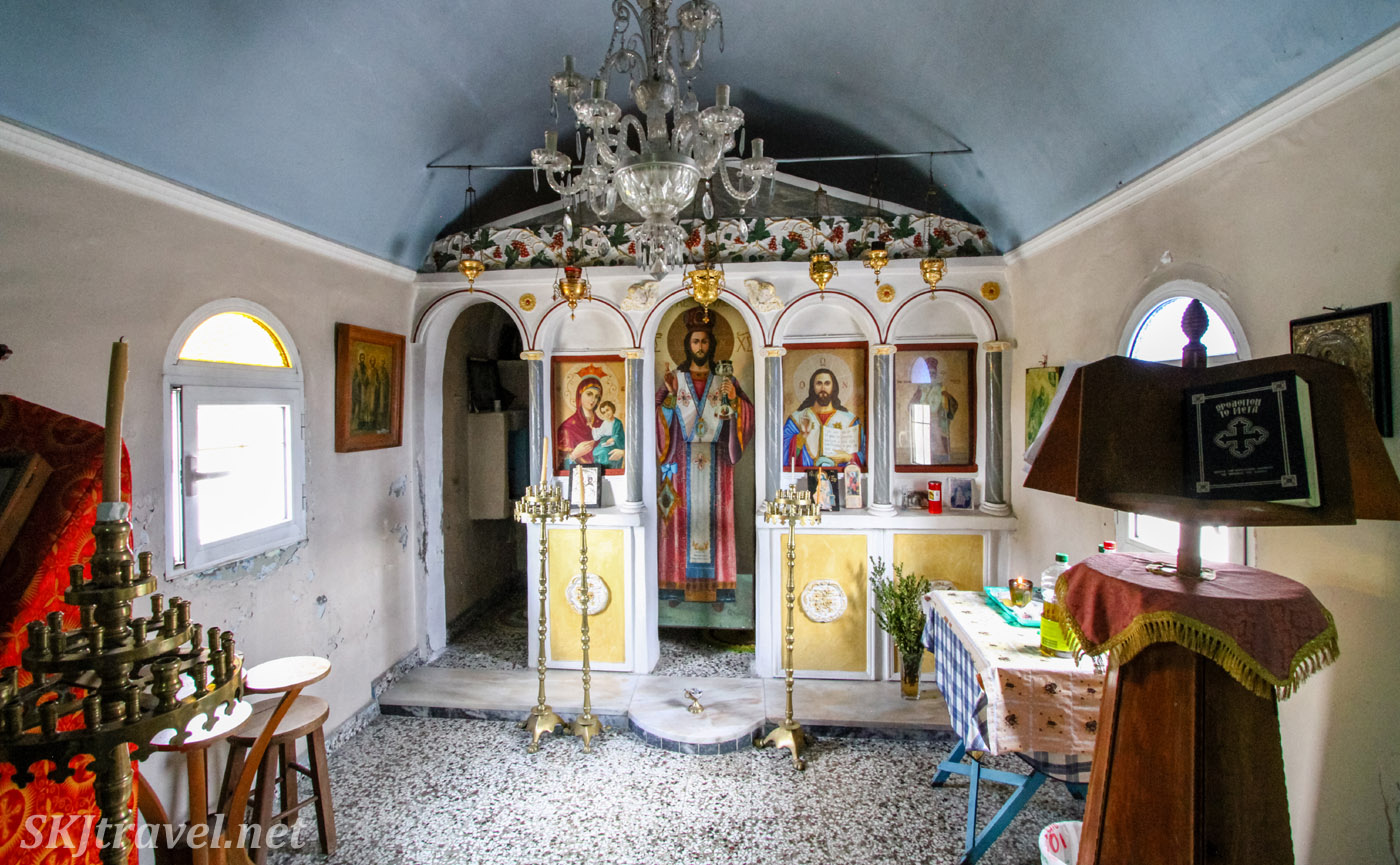 Colorful interior of tiny orthodox church along the roadside on Chios Island, Greece.