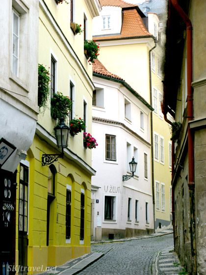 Typical narrow cobblestone street in Prague.