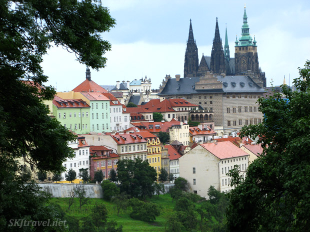 Overlooking Prague. Colorful buildings and St Vitus Cathedral.