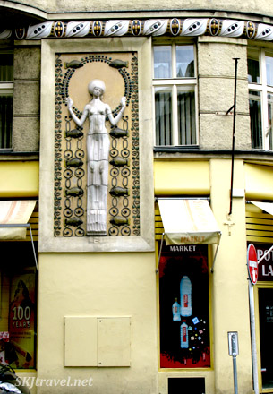 Fun (and typical) street corner statue. Goddess figure.