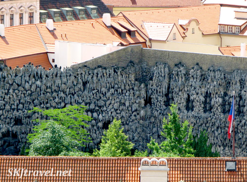 Looking down into the funky walls of modern sculpture. Prague.