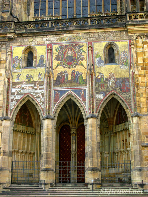 Walking by the gilded exterior of St. Vitus cathedral in the early morning. Prague.