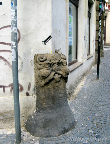 Whimsical cornerstone of a building in Prague.