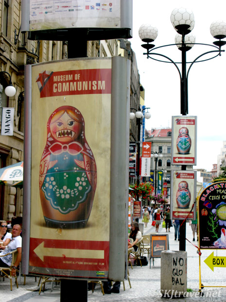Nesting doll with fangs, the logo icon for the Museum of Communism in Prague.