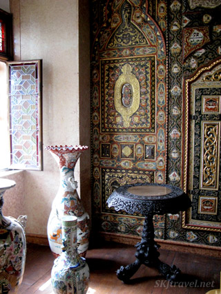 Ornate Asian vase and wall decoration