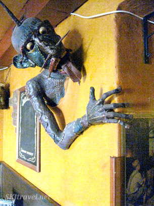 Totally creepy sculpture of unicorn man coming out of the wall in the pub in Bratislava, Slovakia.
