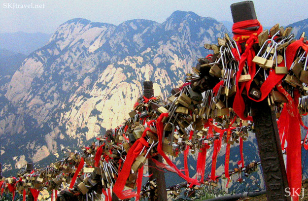 Lovers locks and red ribbons on Huashan mountain, Shaanxi Province, China.