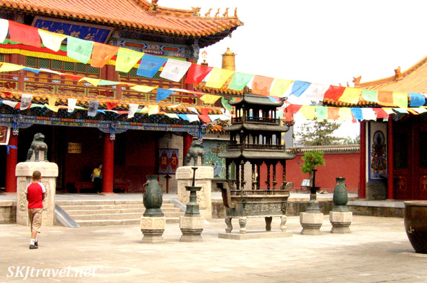temple courtyard with colorful prayer flags