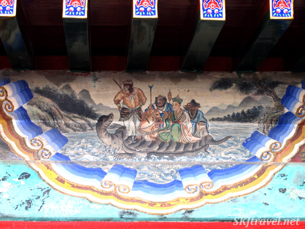 Mythical painting along the Long Corridor ... looks like guys riding a turtle. Summer Palace, China.