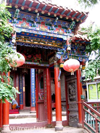 Intricately painted eaves and pillars entering Gao Miao. Zhongwei, China.
