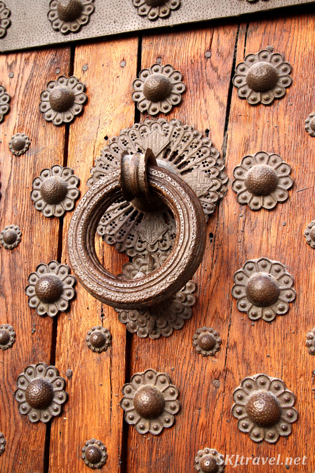 Ornate knocker on a door in the Gothic Quarter of Barcelona, Spain.