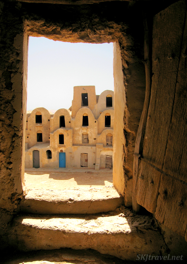 Looking through a door in the outer wall into the courtyard of an old Berber ksar, Tunisia.