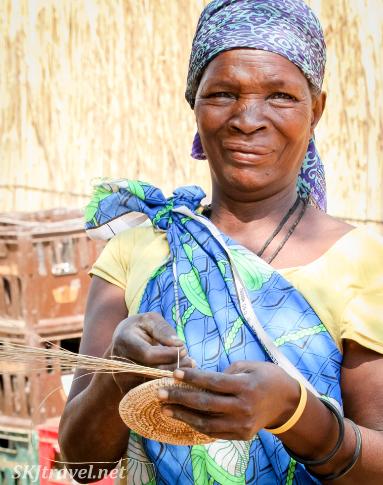 Kavango woman and traditional plant weaving. Divundu, Namibia.