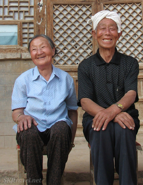 Papa and Mama Dang, smiling like always, rural village of Dang Jiashan, Shaanxi Province, China.