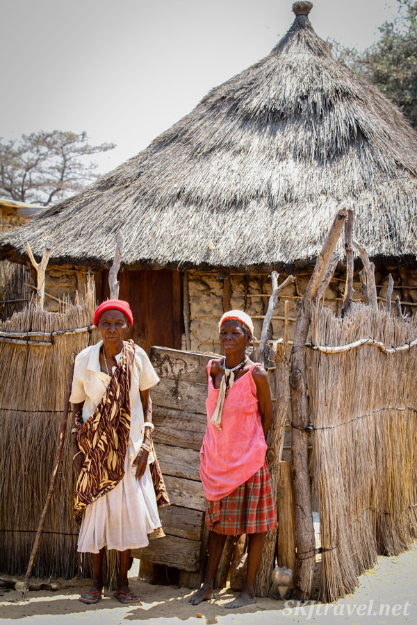 Granny Sabina and her daughter standing outside Granny's hut inside her family compound, Divundu, Kavango region, Namibia.