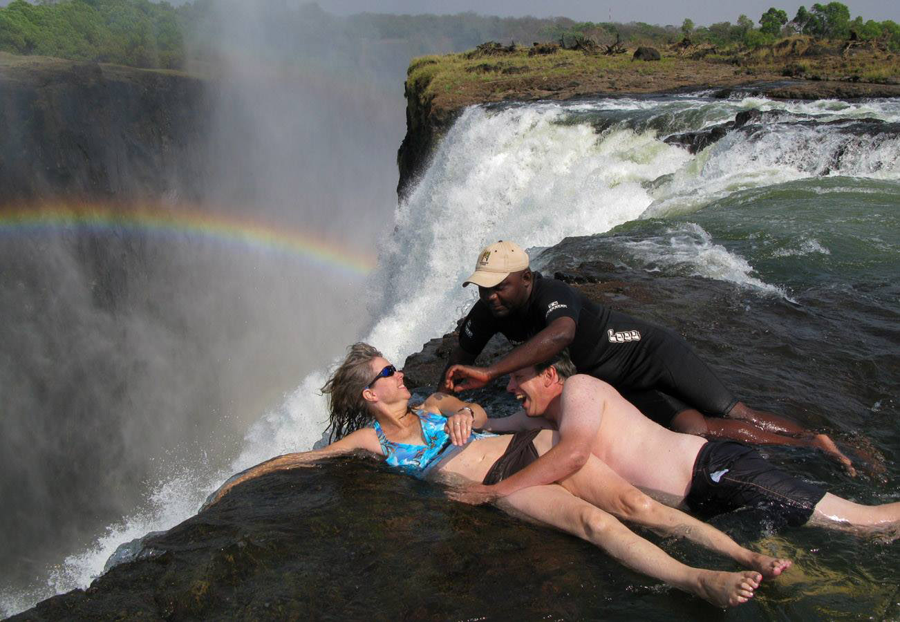 At the edge of Victoria Falls, Zambia, in the Devil's Pool.