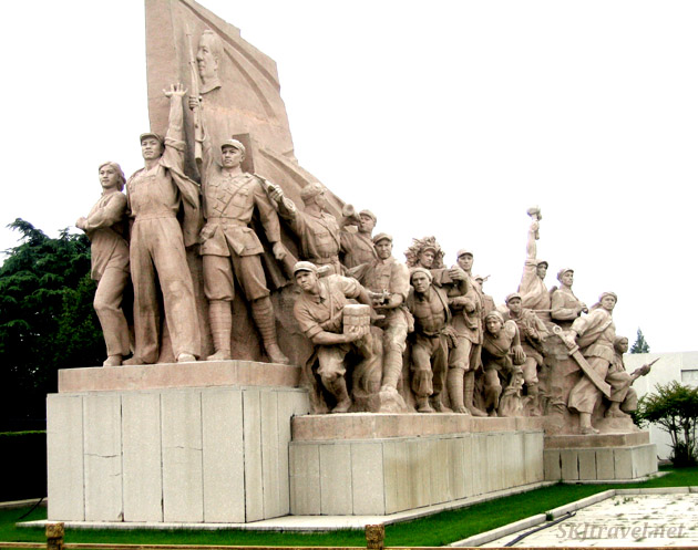 Stone carving of workers and revolutionaries in Tiananmen Square. Beijing.
