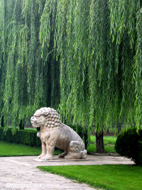Stone statue of lion along the Sacred Way, or Spirit Way, at the Ming Tombs outside Beijing, China.