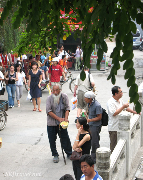 Crowded bridge at the Back Lakes in Beijing, China.