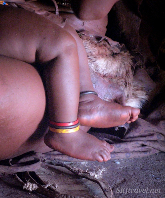 Foot of a Himba infant inside a hut, Kaokoland, Namibia.