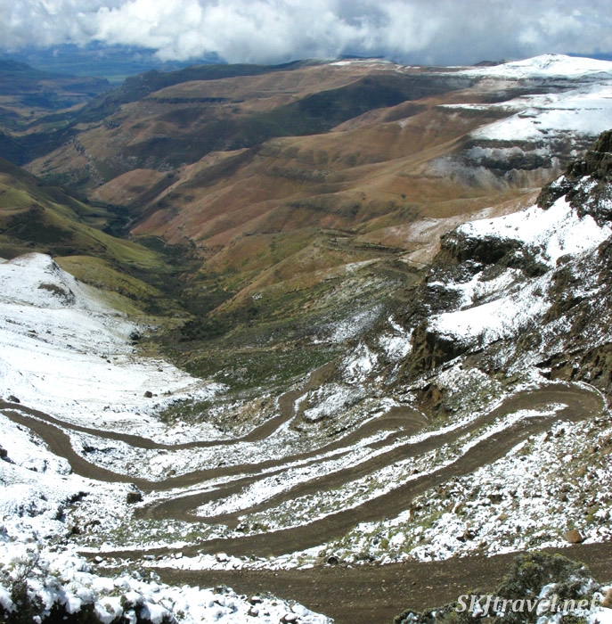 snow covered mountains and twisty road below. Lesotho