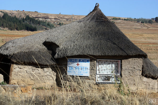 Mud brick rondeval with thatched roof doctor's office. Lesotho