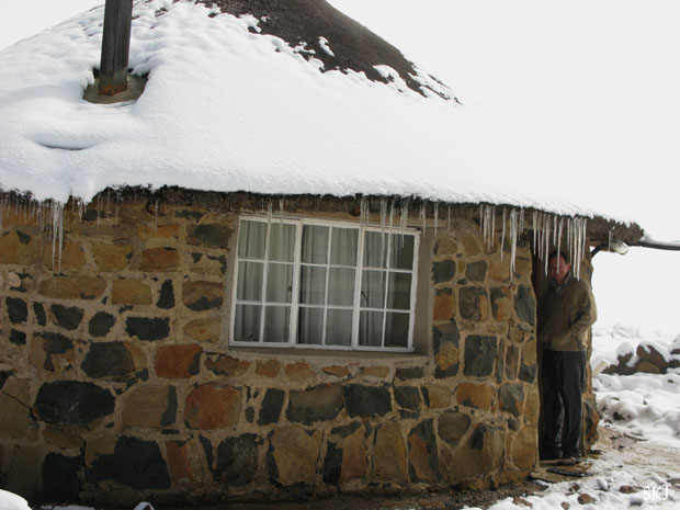 rondeval covered in snow and long icicles hanging from roof. Lesotho