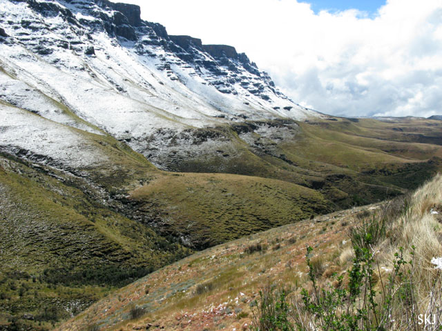rolling hills with snow on top and green grass on bottom. Lesotho