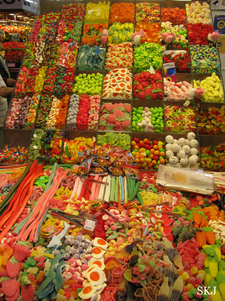 Many bins of colorful candy inside the market along the Ramblas. photo by Shara Johnson