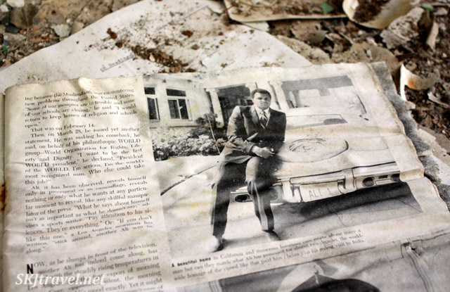 Old newspaper article about Mohammad Ali lying on the floor of an abandoned building in Gilman, Colorado.