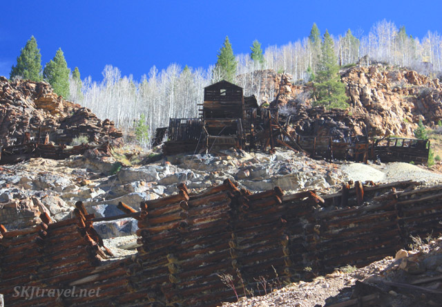Ruins of wooden buildings used in mining along the abandoned railroad tracks leading to Gilman, Colorado.