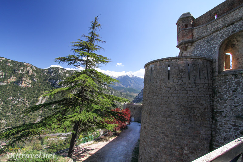 Walking along the fortress walls to Fort Liberia above Villefranche de Conflent, France. The French Pyrenees.