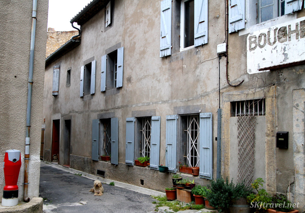 A lone villager rests on a street in Lagrasse, France.