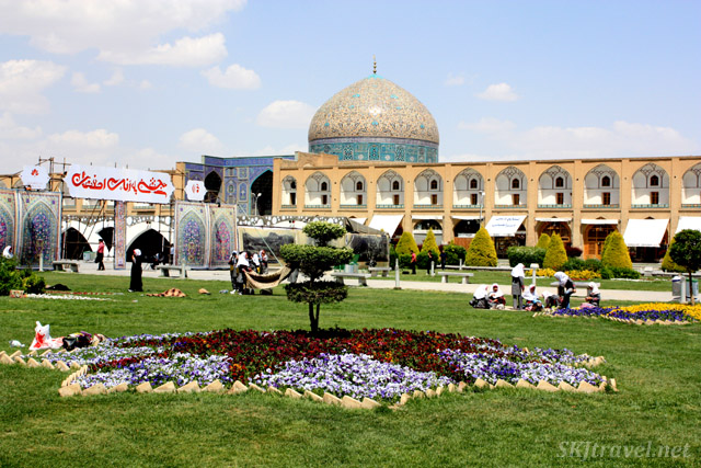 Flowers in the Imam Square, Isfahan. An arts and crafts show is being set up in the middle of it.